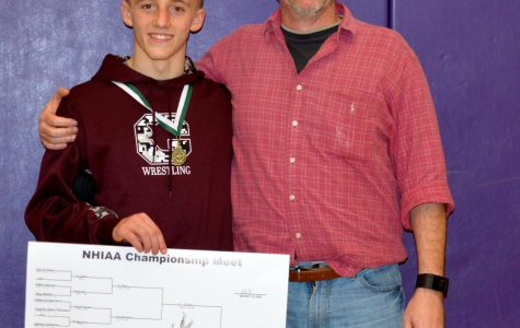Dana Dennis alongside his nephew Jac after his All-State wrestling tournament.