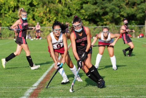 Jessica Vo plays defense against masked Bedford player. Photo Credit: Karen Charron